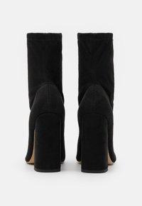Missguided - FLARED HEEL SOCK BOOT - Bottines - black - 3