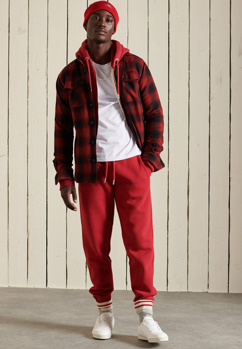 Superdry - Tracksuit bottoms - rich red marl