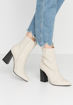 ARI - High heeled ankle boots - nude