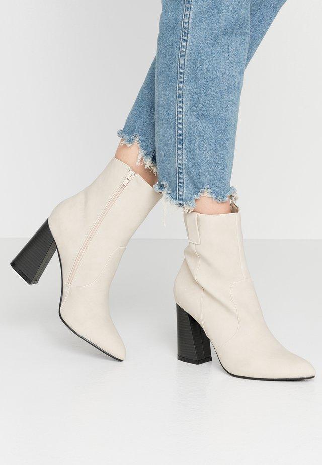 ARI - High heeled ankle boots - nude