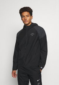 Nike Performance - NIKE RUN DIVISION FLASH - Sports jacket - black/silver - 0