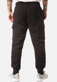 Nike Sportswear - CLUB PANT - Pantalones cargo - black - 1