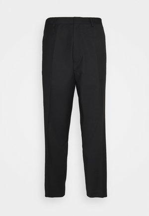 REVOLTE UNISEX - Pantaloni - black