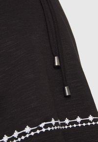 MAMALICIOUS - MLKATE TESS - Print T-shirt - black/white - 2