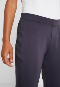 Nike Golf - WOMEN NIKE POWER PANT SLIM  - Trousers - gridiron