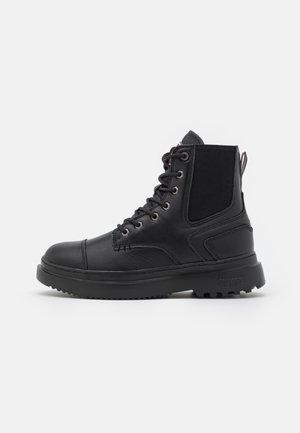CONNOR MOTO - Platform ankle boots - black