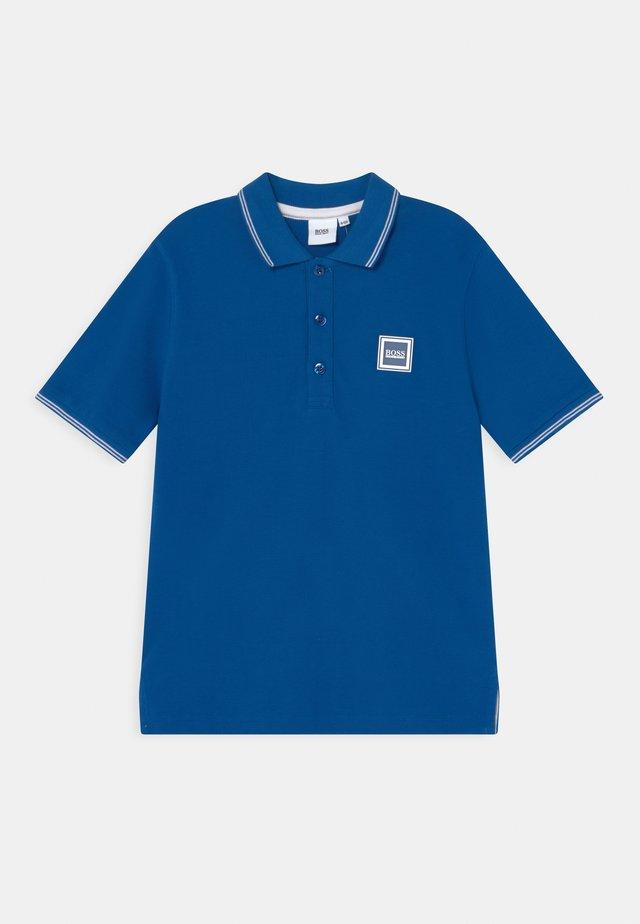 Polo shirt - pale blue