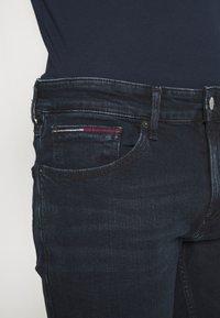Tommy Jeans - SCANTON SLIM - Slim fit jeans - midnight extra dark blue - 4