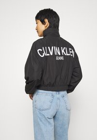 Calvin Klein Jeans - BACK LOGO - Windbreaker - black - 2