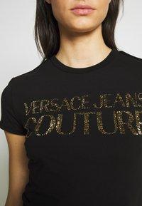 Versace Jeans Couture - LADY - Triko spotiskem - black/gold - 6