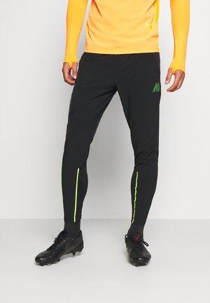 MERC DRY  - Teplákové kalhoty - black/volt/volt