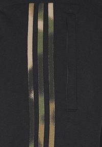 adidas Originals - CAMO  - Tracksuit bottoms - black/wild pine/multicolor - 5