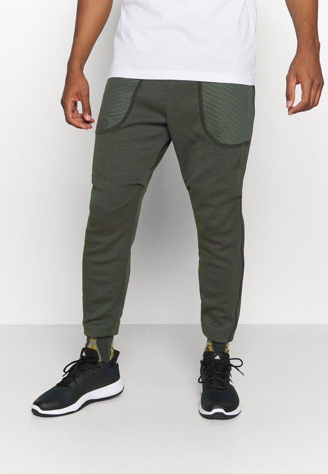 ATHLETICS TECH COLD.RDY SPORTS PANTS - Teplákové kalhoty - dark green