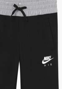 Nike Sportswear - Tracksuit bottoms - black/white - 2