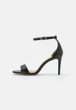 TATUM - Sandals - black