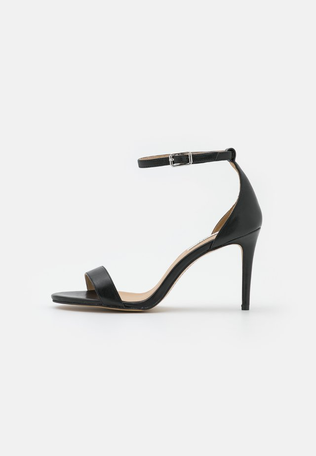 TATUM - Sandals - black