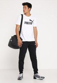 Puma - LOGO TEE - T-shirt con stampa - white - 1