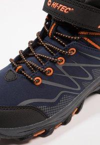 Hi-Tec - BLACKOUT MID WP JR - Hiking shoes - navy/orange - 2