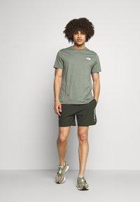 SQUATWOLF - WARRIOR SHORTS - Sports shorts - olive - 1