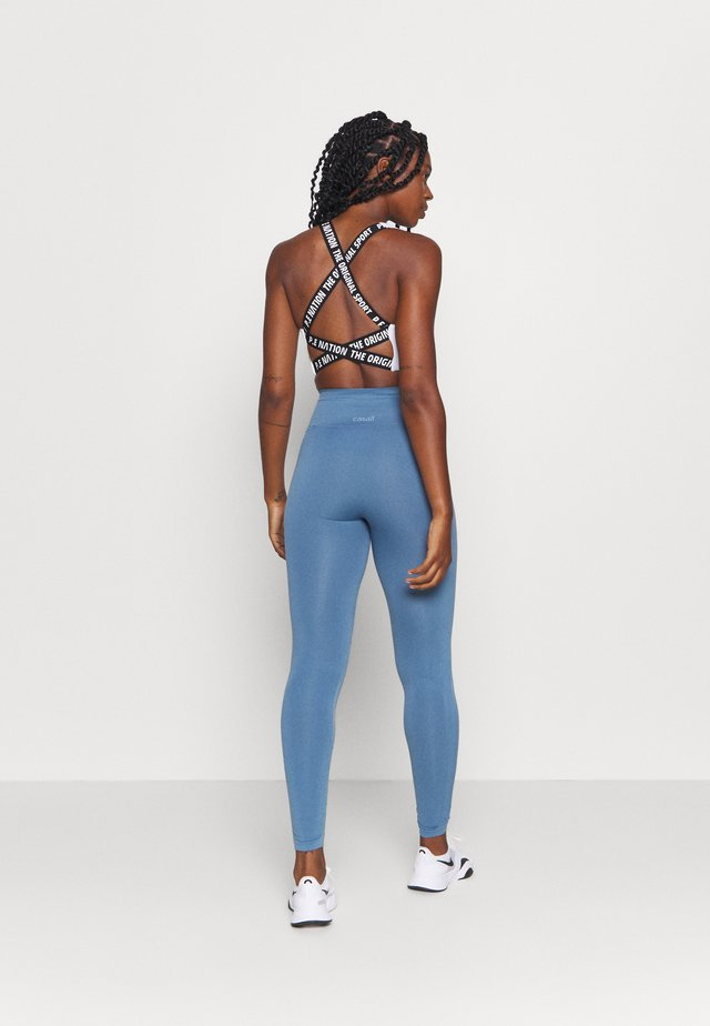 ESSENTIAL SEAMLESS  - Collant - inclusive blue