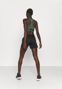 adidas Performance - TIRO PRIDE - Pantalón corto de deporte - black - 2