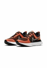 Nike Performance - REACT INFINITY RUN FK 2 - Neutral running shoes - bright mango black white - 1