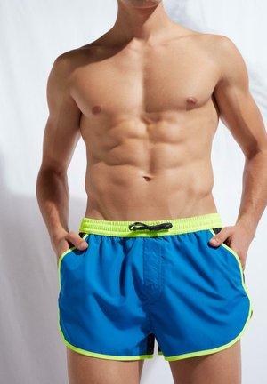 Swimming shorts - capri/deep blue/yellow neon