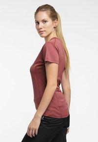 Haglöfs - L.I.M STRIVE TEE - Print T-shirt - maroon red - 2