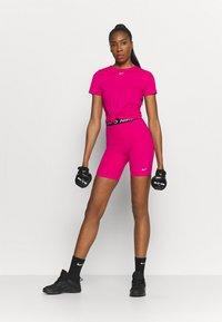 Nike Performance - ALL OVER - Camiseta básica - fireberry/white - 1