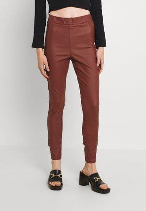 BYKIKO - Leggings - Trousers - brown