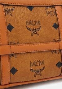 MCM - DELMY SHOULDER BAG IN VISETOS - Handbag - cognac - 4
