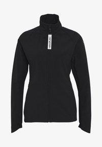 RAUVOLA - Training jacket - black