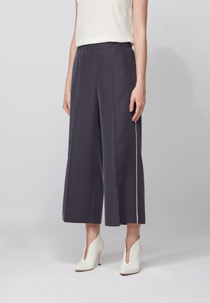 SIAMO - Trousers - open blue