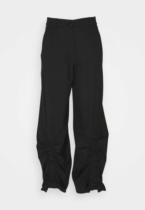 BURNING LOVE PANTS - Trousers - black