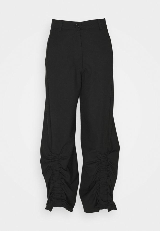 BURNING LOVE PANTS - Pantaloni - black