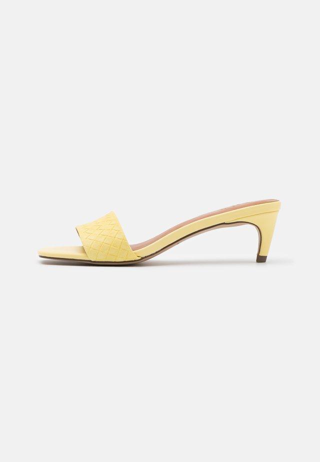 AABELLA - Heeled mules - light yellow