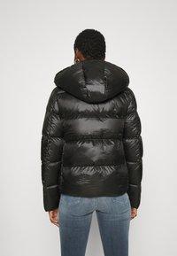 Calvin Klein Jeans - SHINY PUFFER - Down jacket - black - 2