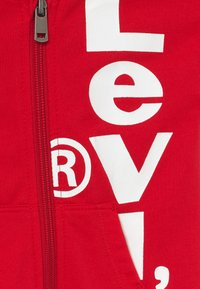 Levi's® - PLAY ALL DAY COVERALL - Jumpsuit - super red - 4