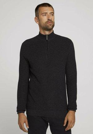 Stickad tröja - black grey melange