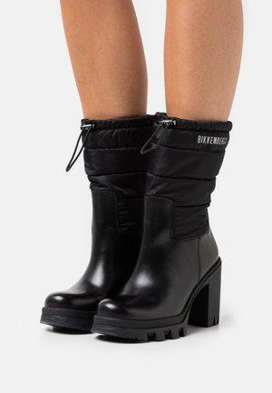 PHILDE - Platform ankle boots - black