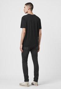 AllSaints - CIGARETTE - Slim fit jeans - black - 2