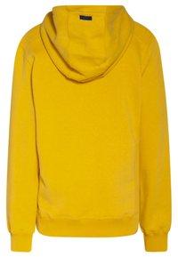 WE Fashion - REGULAR FIT - Hoodie - ochre yellow - 1