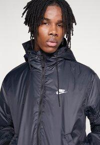 Nike Sportswear - M NSW HE WR JKT HD REV INSLTD - Kurtka przejściowa - black - 6