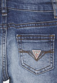 Guess - SKINNY PANTS BABY - Jeans Skinny Fit - shiny letters blue - 2