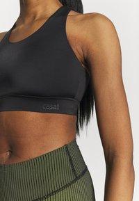 Casall - CROSSBACK  - Medium support sports bra - black - 3