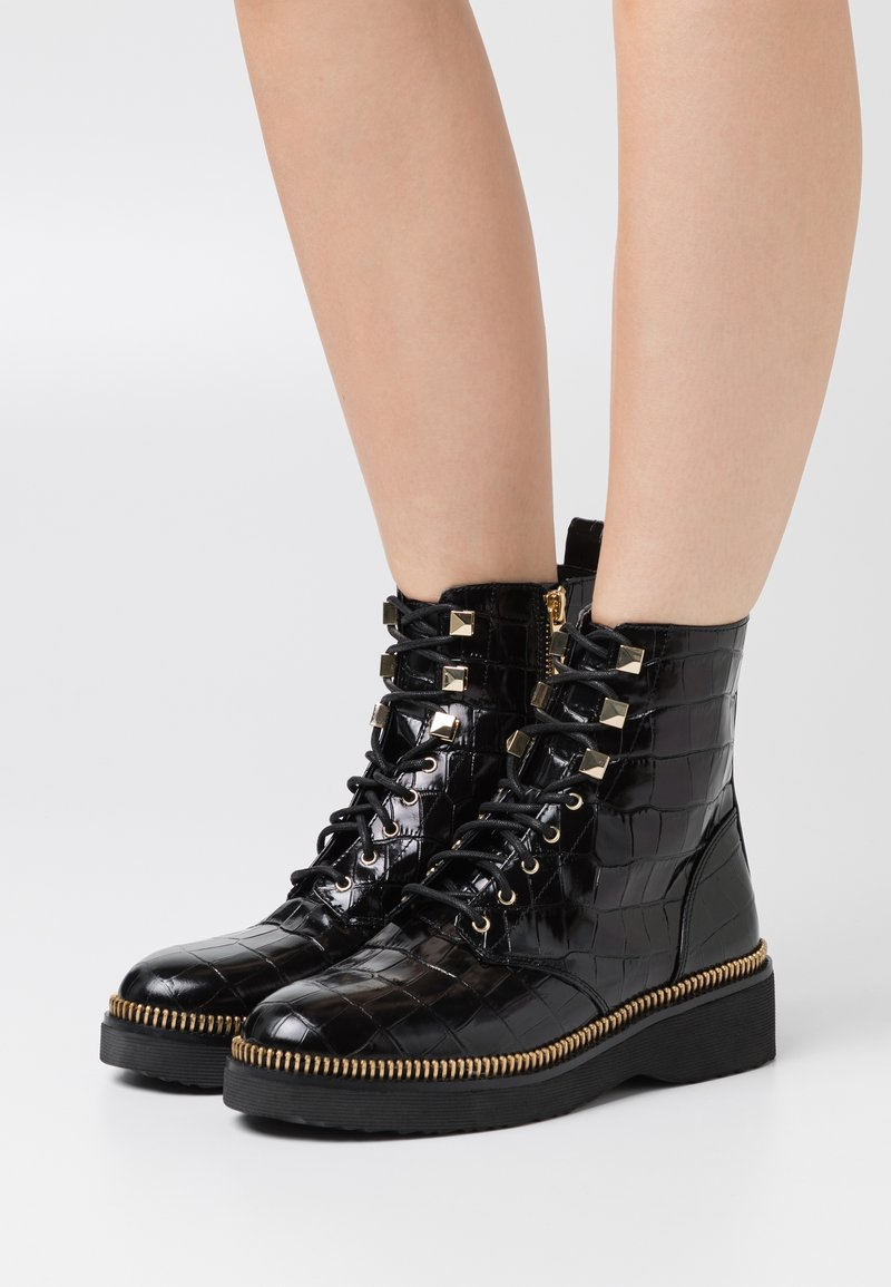 MICHAEL Michael Kors - HASKELL BOOTIE - Lace-up ankle boots - black