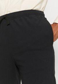 The North Face - GLACIER PANT - Spodnie treningowe - black - 3