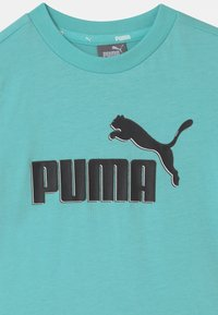 Puma - MINICATS SET UNISEX - Camiseta estampada - light blue