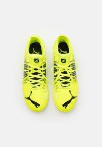 Puma - FUTURE Z 4.1 TT JR UNISEX - Astro turf trainers - yellow alert/black/white - 3