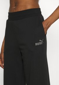 Puma - EMBROIDERED WIDE PANTS - Tracksuit bottoms - black - 4